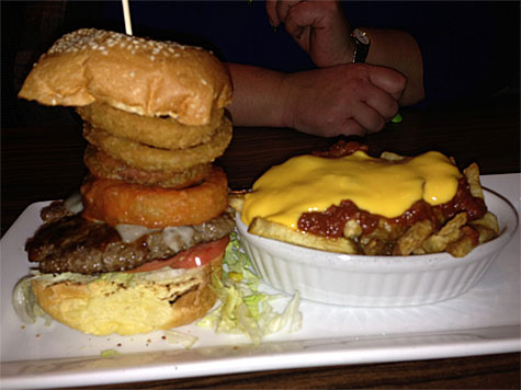 Mike's mom's BYOB: Beef, Garlic Mayo, Ketchup, Mozza Cheese, Onion Rings, Iceberg Lettuce, Tomato, Buffalo Onion Rings on a Sesame Seed Bun with Chili Cheese Fries.