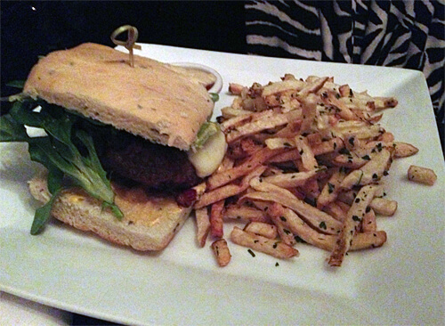 Umami Burger - Dashi soaked flank, spicy aioli, smoky cheese, bacon, caramelized onions and fries ($14)