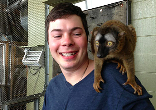 Mike hanging with a bewildered lemur.