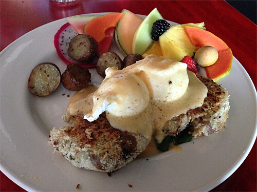Crab Cake Benny - three kinds of crabmeat, cod, potato and herbs, served on spinach. ($15.95)