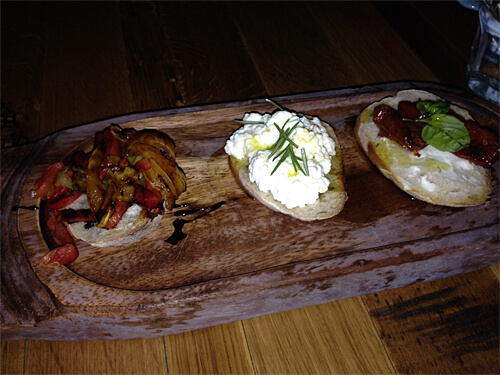 Trittico di Bruschetta - Three types of bruschetta (marinated roasted pepers, house-made ricotta, oven-roasted tomato with chevre-cheese) - $10