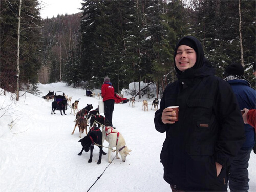 Mike having some hot apple cider after dogsledding in the Canadian Rockies!