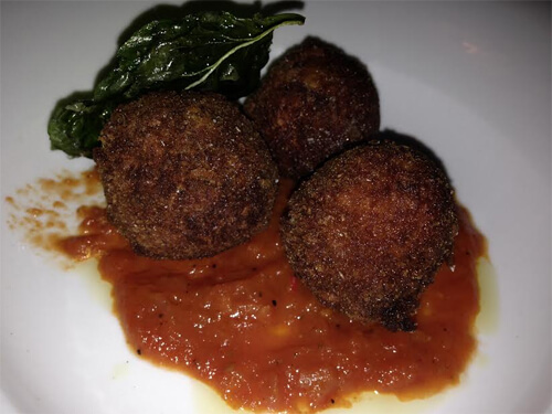 Arancini (prairie mushrooms, mozza, absynthe-arrabiata sauce) - $11
