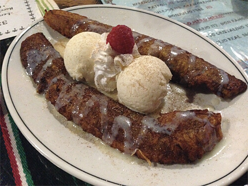 Fried Plantain - plantain sprinkled with cinnamon and sugar, and drizzled with lechera and caramel, served with two scoops of vanilla ice cream. $6.99