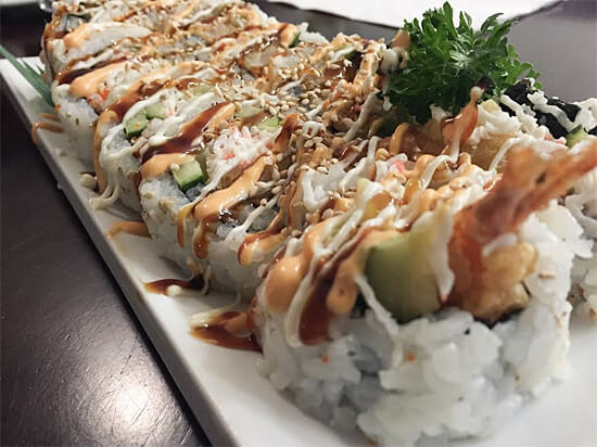 Dynamite Big Roll (10 pieces) - Big size roll, deep fried prawn, avocado, cucumber, imitation crab, flying fish roe, spicy sauce, mayo and house sauce - $14