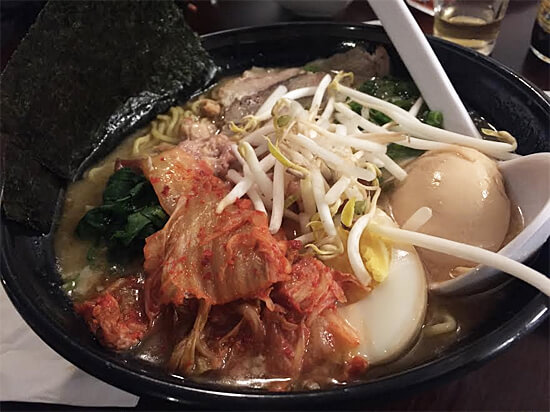 Kimuchi Ramen - Miso broth with spicy groun pork kimchi, Japanese chili oil, vegetable (topping choice $1 each - boiled egg, chicken, sliced pork, and corn) - $12