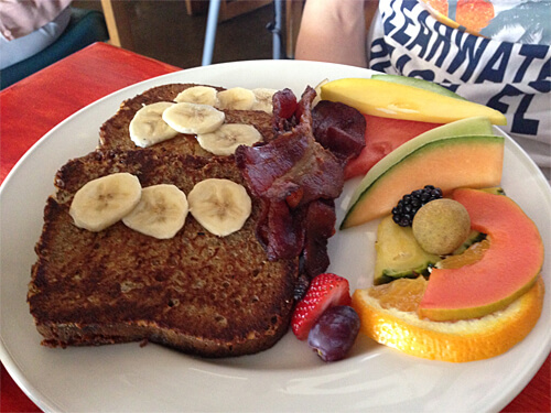 Banana Bread French Toast - with fresh bananas, served with maple syrup, fresh fruit and bacon ($15).