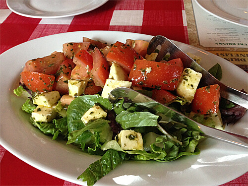 Tomato Bocconcini Salad (Roma Tomatoes layered with Imported Bocconcini Cheese) at Cafe Amore. ($11)