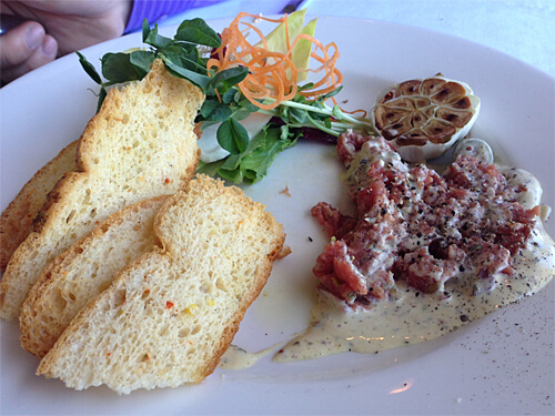 Steak Tartare (fresh AAA chopped Alberta Beef Tenderloin mixture served with toast crisps, greens and peppered Dijon mustard) at La Ronde Revolving Restaurant. ($18)