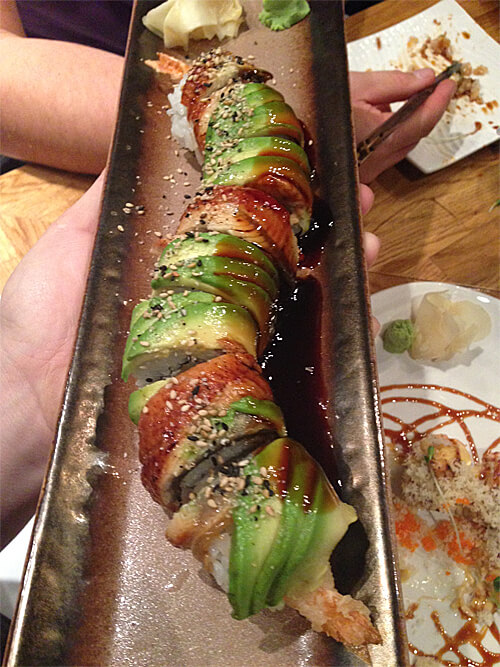 Cheezy Dragon rolls - shrimp tempura, cream cheese roll topped with eel, avocado, sweet soy and sesame seeds - $15.95