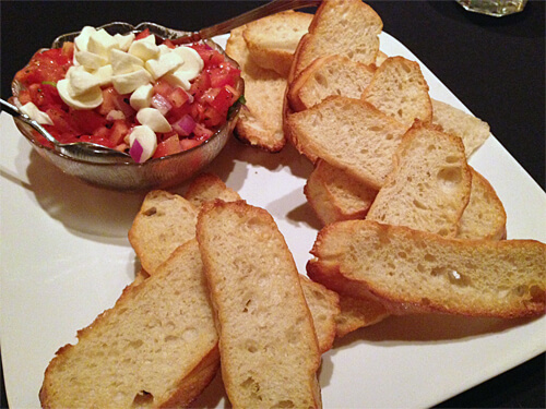 Bocconcini Cheese Bruschetta - Diced roma tomatoes, garlic, fresh herbs, olive oil and balsamic vinegar with bocconcini - $14