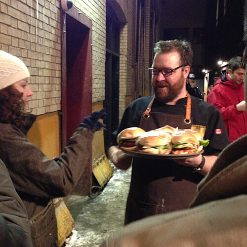 Chef Andrew Cowan delivering the #yegalleyburger goods.