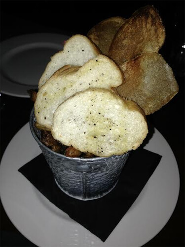 A side of fries, bread, and potato chips (came with the mussels)