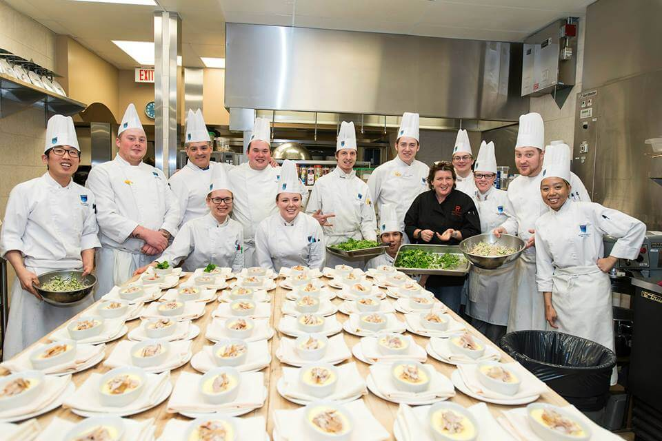 NAIT Chef in Residence Lynn Crawford with Culinary students ahead of 'Lunch with Lynn'. Photo Credit: NAIT/John Book.