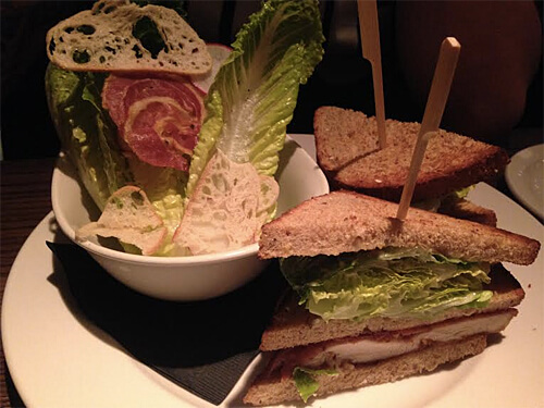 Picnic Chicken Club - Fried Chicken, Irvings Farm Bacon, Romaine Lettuce, Tomatoes, House-made Mayo, Fresh Prairie Mill's Nine Grain Bread with Parlour Caesar ($16)