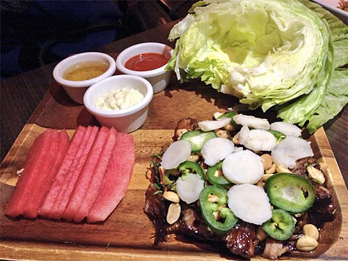 Pork Belly Lettuce Wraps - Watermelon, peanuts, mint, trio of sauces - ginger, sriracha, mayo ($16)