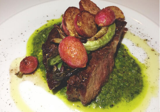 35 day aged 10 oz. Ribeye with charred radishes, spring onions and salsa verde at Corso 32 ($35)