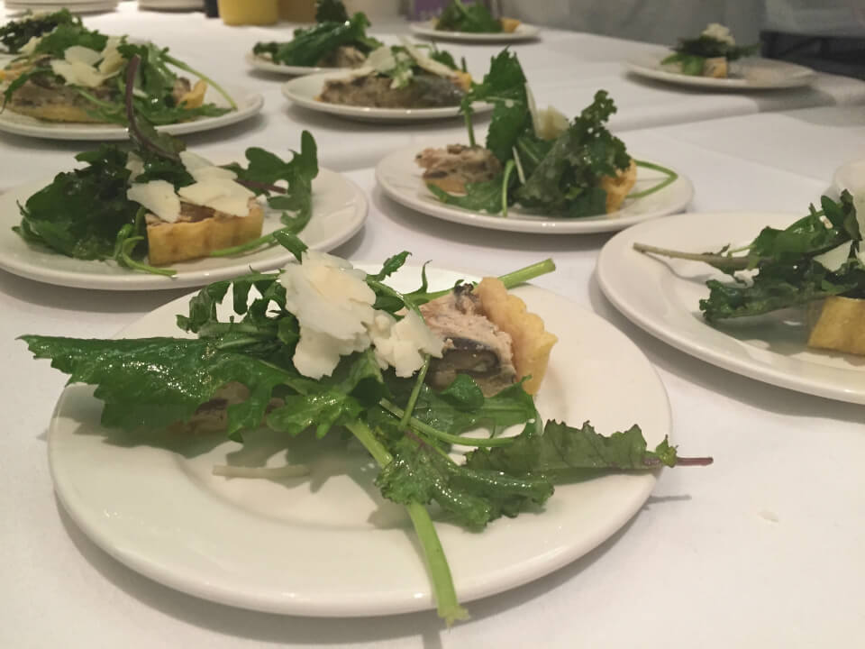 NAIT's School of Hospitality and Culinary Arts' Cheesiry Fresco Tart with wild mushroom, caramelized onion and arugula salad.