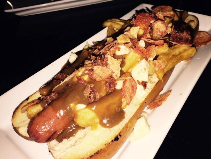 The oversized, foot-long Team Canada Poutine Hot Dog FIFA Women's World Cup special at The Pint!
